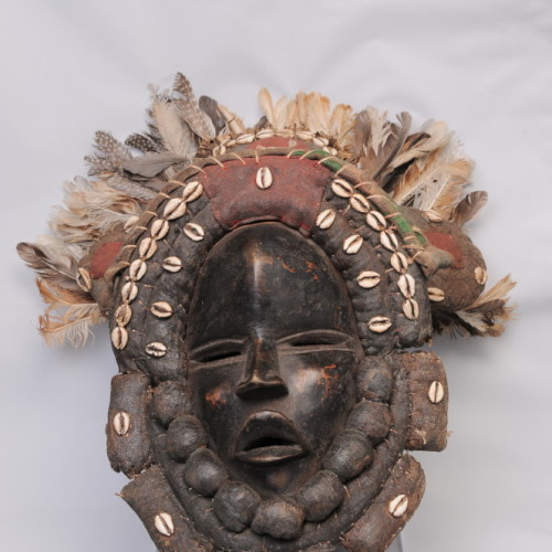Dan mask, cowry shells and feathers, Ivory Coast